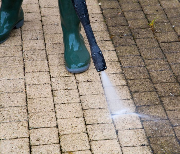 pressure washer completing paver cleaning for a clearwater patio